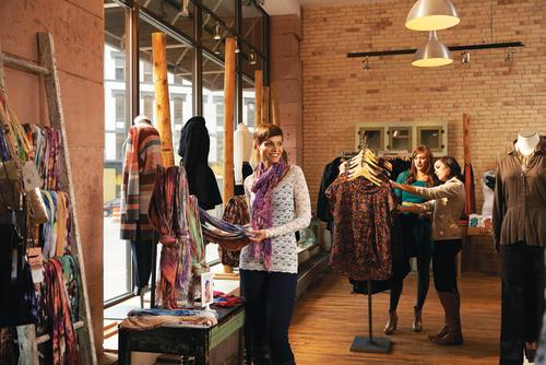 Shoppers browse clothing goods at Lee and Birch
