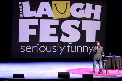 Gilda's LaughFest Comedian performing on stage