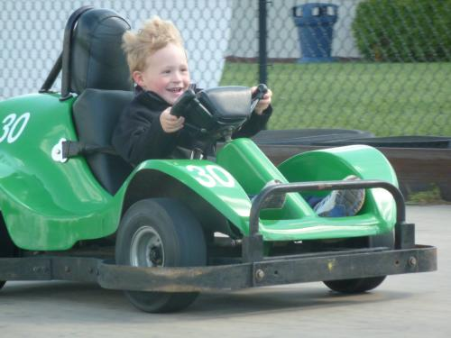 boy driving go-kart at AJ's Family Fun Center