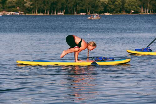 Woman completing Funky Buddha's paddleboard yoga