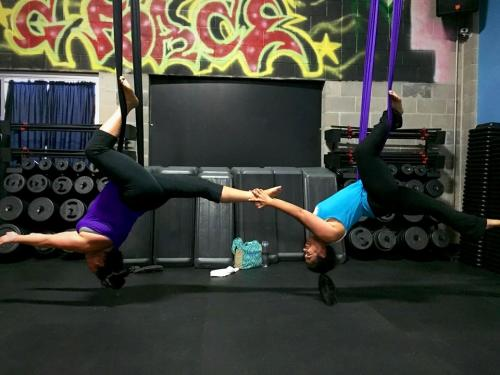 women attending a G-Force Fitness aerial yoga class