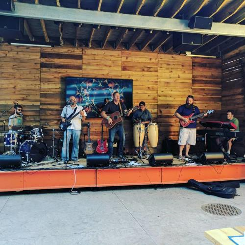 Band performing on the Knickerbocker Outdoor Stage in Grand Rapids