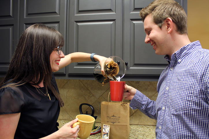 Two people enjoying coffee from a craft