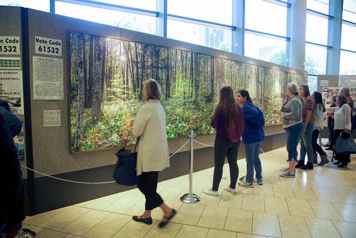 People enjoying the ArtPrize Northwood Awakening exhibit