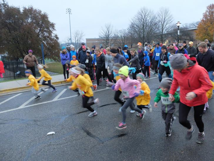 Adults and kids running at the Gobble Wobble run in East Grand Rapids