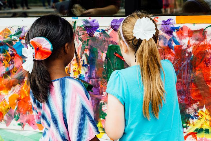 Girls painting during Children's Museum ArtFest in Grand Rapids, Michigan