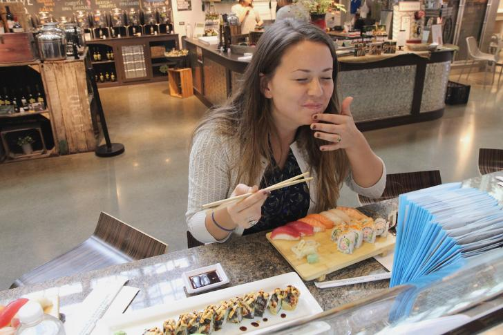 Woman dining at Sushi Market in Downtown Market Grand Rapids