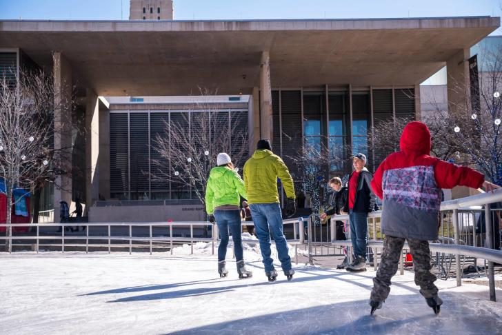 People ice skating at Rosa Parks Circle in Grand Rapids