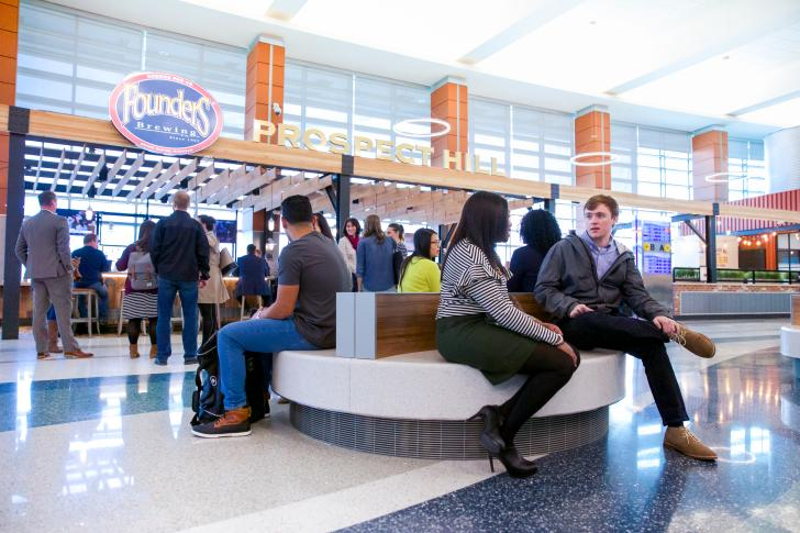 Passengers at Prospect Hill by Founders Brewing at the Grand Rapids Airport