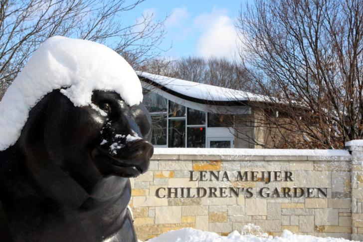 Snow covered bear statue at Frederik Meijer Gardens