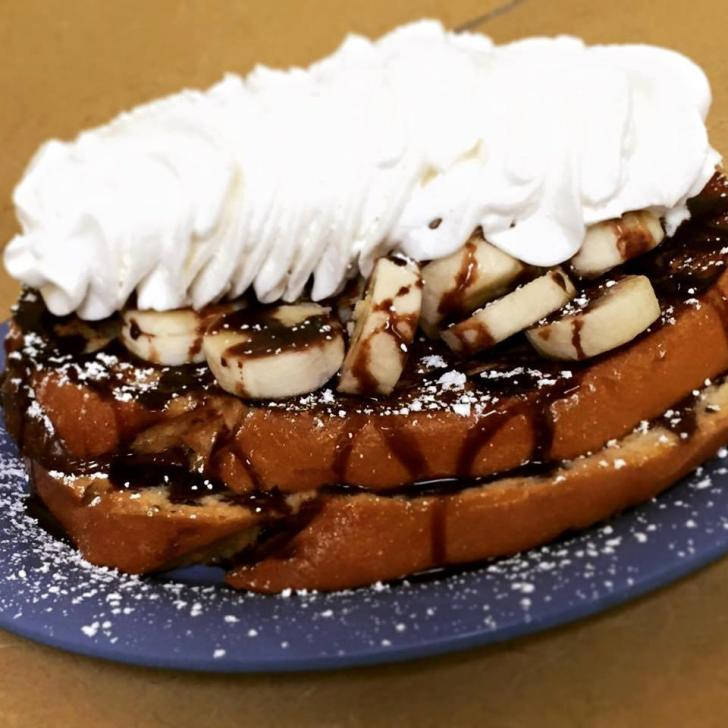 French toast with bananas and whipped cream from Real Food Cafe