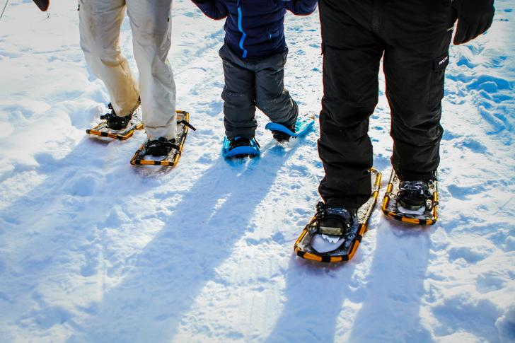 Family wearing snowshoes in Grand Rapids, Michigan