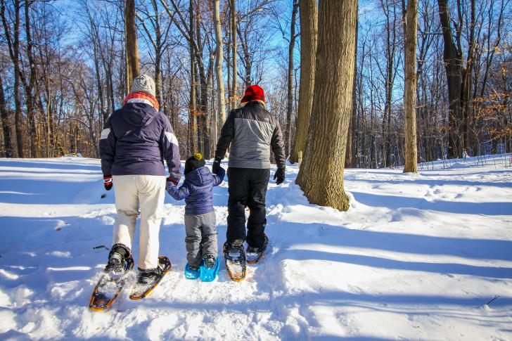 Family snowshoeing together on the Blandford Nature Center trails