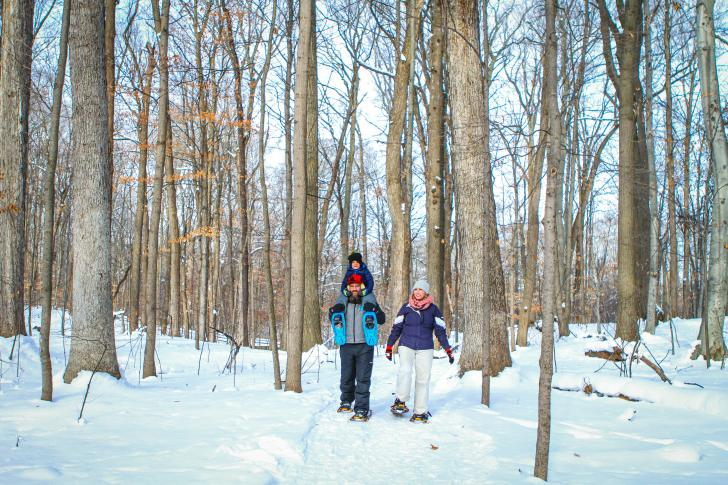 Family snowshoeing at Blandford Nature Center in Grand Rapids