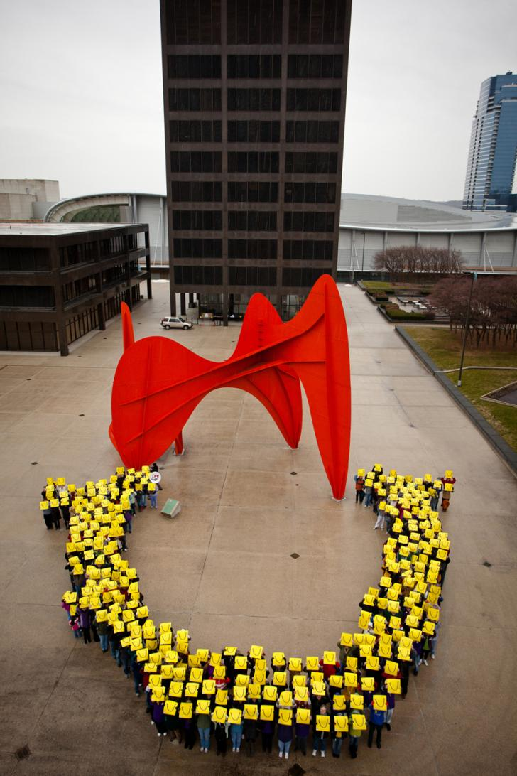 People forming LaughFest logo at Calder Plaza in Grand Rapids for LaughFest 2011