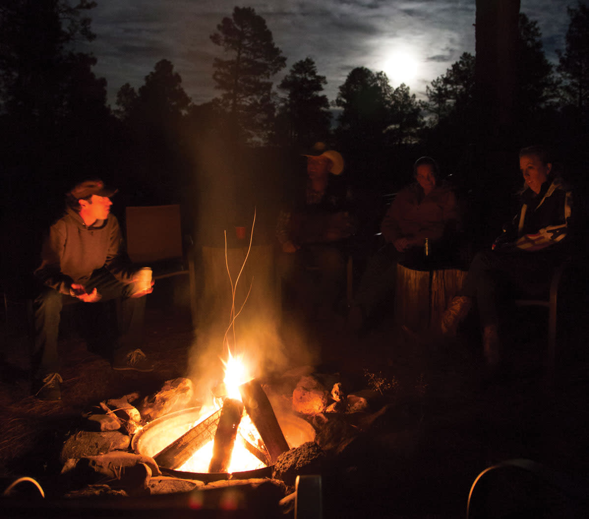 Riders around the campfire at Geronimo Trail Ranch