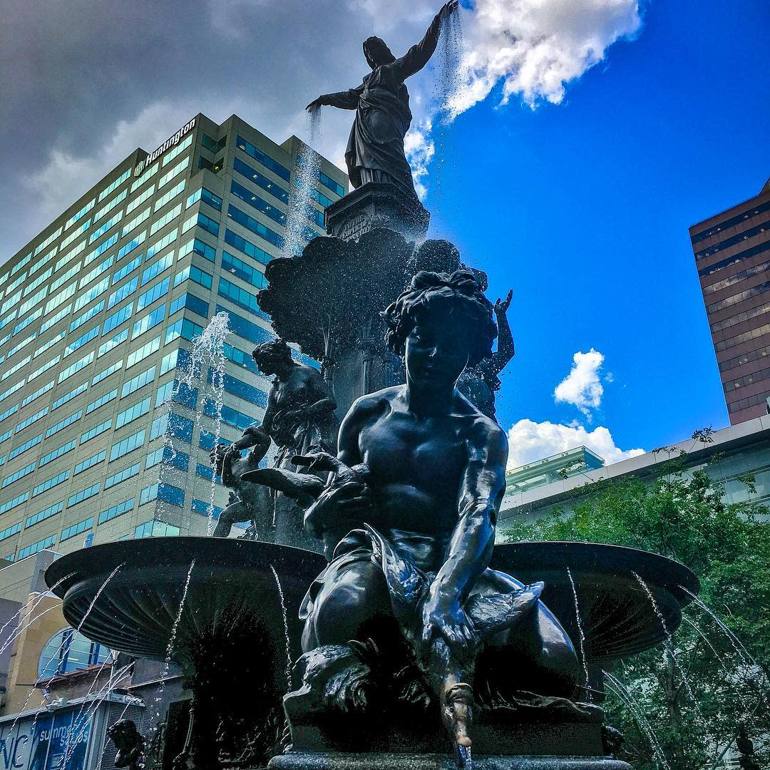 the genius of water statue at fountain square