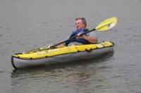 U.S. Coast Guard Auxiliaryman Gene Little demonstrates the Safe n Sight decals that make kayak paddles more visible. Photo: New York Sea Grant