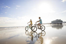 Couples on bikes on beach