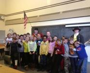 """Shaun Pekar and Cameron Green are shown here with a class of elementary school students at a recent outreach program entitled """"A Soldier's Life at Fort Ticonderoga.""""  Fort Ticonderoga expects to nearly double its reach to students in 2013 through several new educational initiatives."""
