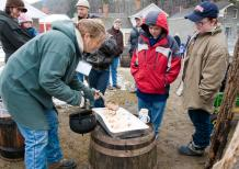 Visitors to Sugaring Off Sundays at The Farmers' Museum in Cooperstown enjoy the sweet taste of jack wax, an old tradition in maple syrup country. (Photo by Zach Winnie)