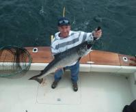 A WHALE OF A FISH!  – Brian Franklin of Newville, PA, shows off his 26 ½ pound salmon caught on Lake Ontario with Captain Greg Gehrig of Top Gun Charters in Oswego. This year marks the best fishing many anglers have seen in more than two decades, in part due to the recent mild winter in Oswego County. Photo courtesy of Capt. Gehrig.