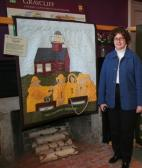 """Great Lakes Seaway Trail President Teresa Mitchell is seen with the quilt, """"Our Seaway Trail Lighthouse Adventure,"""" made by Nancy Smith of Syracuse to commemorate her family's visit to Selkirk Lighthouse on the Seaway Trail. Smith won the 2006 Great Lakes Seaway Trail Quilt Show competition and the overnight stay at the historic lighthouse at Port Ontario in Oswego County."""