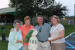 Photo caption:  From left, Raffle Winners Darla Perham, Priscilla Curthoys, David and Jennifer Connolly split $11,000
