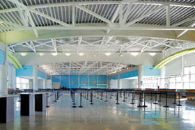 Interior photo of Cruise Terminal 21 passenger check-in area