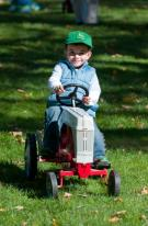 """A young tractor enthusiast takes part in the """"Kiddie Pedal-Tractor Pull"""" at last year's Tractor Fest at The Farmers' Museum in Cooperstown, NY."""