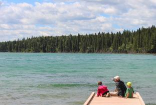 Sitting on the dock with the kids, watching the water at Duck Mountain Provincial Park