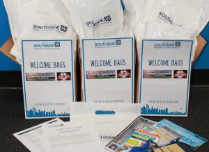 boxes of welcome bags with collateral