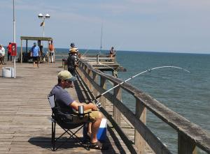Fiherman on Kure Beach Fishing Pier