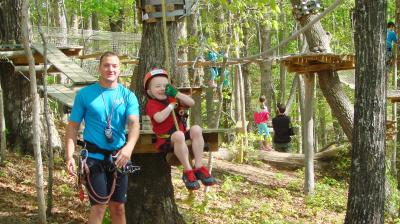 Little Boy Swinging at TreeTop Quest
