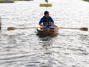 Boat builder Rich Bush rows the dory he made at last year's Great New York State Fair on the pond at the Fair