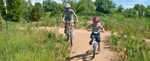 Woman and little boy biking at Valmont Bike Park