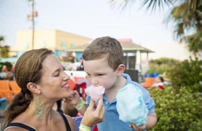 Mom feeding kid cotton candy at the Carolina Beach Boardwalk