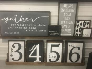 Variety of signs can be found at Norelu Handcrafted Signs & Gifts