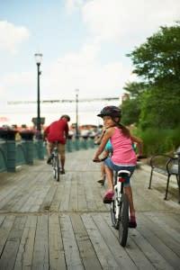 Lansing-River-Trail-girl-on-bike-200x300.jpg