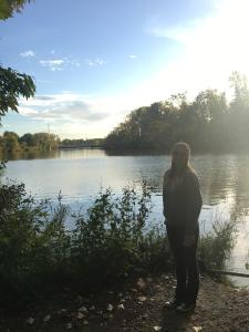 Woman standing by water at IPFW