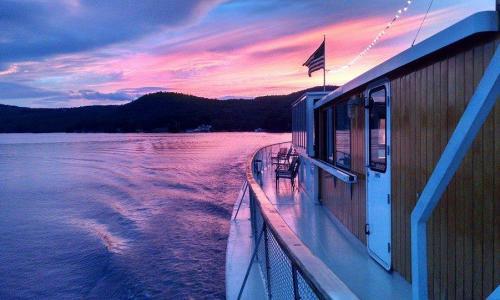 Lake George Shoreline Cruises Boat at Sunset