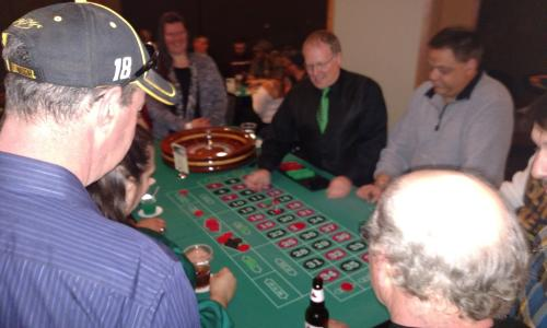 Alpine Amusement man with baseball cap at roulette table