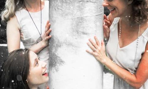 Saratoga Shakespeare Co. women posing around tree