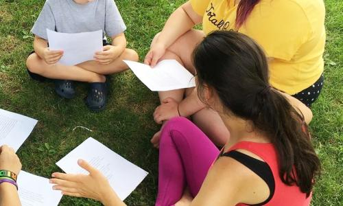 Saratoga Shakespeare Co. actors studying on grass