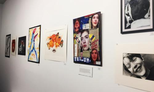 Saratoga Arts Center wall with a few framed pieces of art
