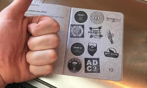 Capital Craft Beverage Trail Passport with thumbs up