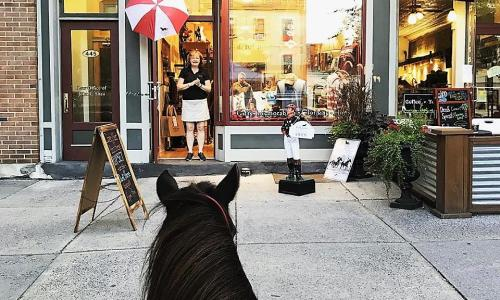 Dark Horse Mercantile Mare standing in front of store