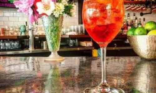 Hamlet and Ghost drink with flowers on the bar