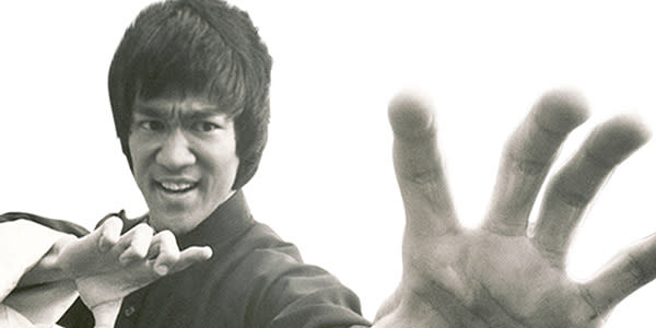 Bruce Lee poses with hand out