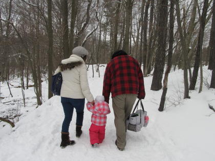 famliy walks through maple trail at Cumming Nature Center in the Finger Lakes